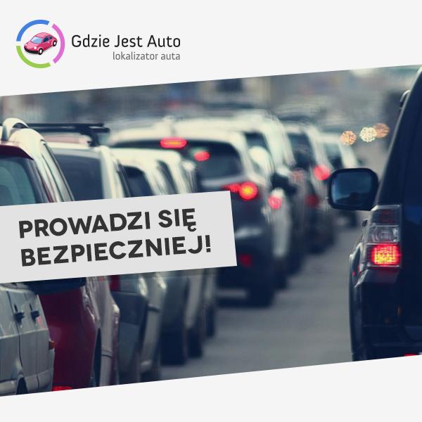 Auta stojące w korku oraz logo aplikacji Gdzie Jest Auto i hasło napisane dużymi literami Prowadzi się bezpieczniej!